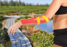 Physiotherapy for elbow pain, aches and tension. Physiotherapy treatment with therapeutic tape for elbow pain, aches and tension. It is also used for prevention royalty free stock image