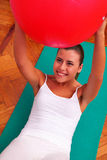 Physiotherapy exercises with bobath ball fitball. In medical studio Stock Image