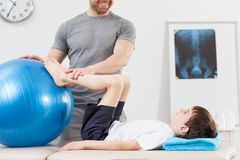 Physiotherapy with fitness ball royalty free stock photography