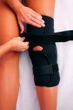 Physiotherapy knee brace stock photography