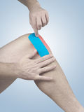 Physiotherapy for knee pain, aches and tension Stock Photo
