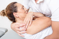 Physiotherapy manipulation. Doctor manipulating the back of a female patient Stock Photography