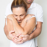 Physiotherapy manipulation. Doctor manipulating the back of a female patient Stock Photo