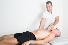 Physiotherapy with older man Royalty Free Stock Photo
