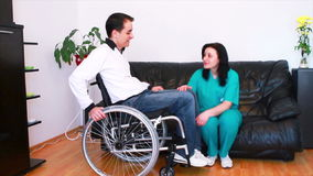 Physiotherapy for patient in wheelchair Stock Photos