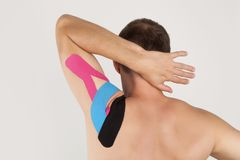 Physiotherapy concept. Kinesiology tape. stock photos