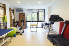 Physiotherapy room in spa center. A physiotherapy room including treadmill, massage table, ball bicycle and other stuff for physical recovery in spa and wellnes Stock Photo