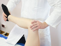 Physiotherapy technique applied to the knee Stock Photo