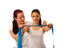 Physiotherapy - therapist doing arm strenghteninh excercises wit Stock Images