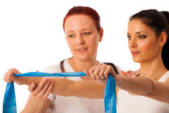 Physiotherapy - therapist doing arm strenghteninh excercises wit Royalty Free Stock Photos