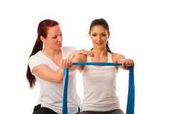 Physiotherapy - therapist doing arm strenghteninh excercises wit Royalty Free Stock Photography