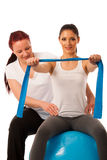 Physiotherapy - therapist doing arm strenghteninh excercises wit Stock Image