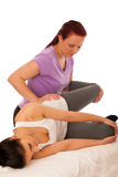 Physiotherapy -therapist excercising with patient , working on l Royalty Free Stock Images