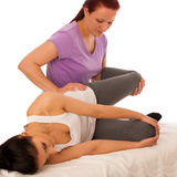 Physiotherapy -therapist excercising with patient , working on l royalty free stock photo