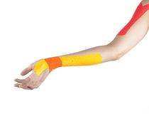 Physiotherapy treatment with therapeutic tape. Royalty Free Stock Images