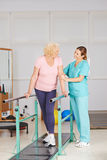 Physiotherapy with walking exercise on treadmill Royalty Free Stock Images