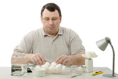 Phytocontrol engineer selecting eggs Royalty Free Stock Photo