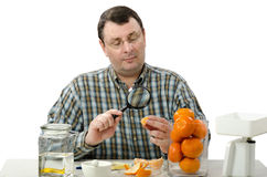 Phytocontrol engineer stares at the mandarine Stock Photos