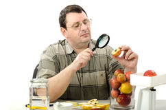 Phytocontrol engineer stares at the rotten apple Stock Images