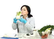 Phytocontrol technician smelling fennel Stock Images