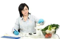Phytocontrol technician weighing garlic bulb Royalty Free Stock Photos
