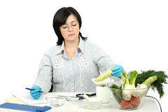 Phytocontrol technician weighing a zucchini Royalty Free Stock Photo