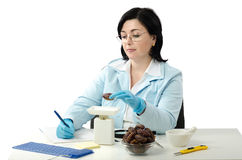 Phytosanitary engineer weighing dates Royalty Free Stock Photography