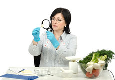 Phytosanitary technician carefully inspecting at a clove of garl Stock Image
