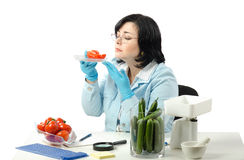 Phytosanitary technician smelling tomato halves Stock Photo