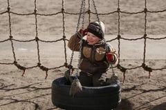 Pièce d'enfants sur la cour de jeu Photo stock