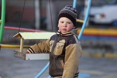 Pièce d'enfants sur la cour de jeu Photographie stock