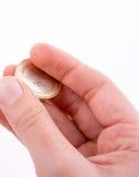 Pièce de monnaie à disposition Photos stock