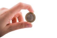 Pièce de monnaie à disposition Photo stock