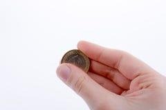 Pièce de monnaie à disposition Photographie stock