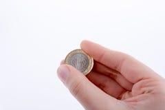 Pièce de monnaie à disposition Photographie stock libre de droits