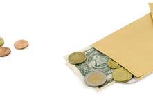 Pièce de monnaie américaine d'evro du dollar d'échange d'argent Photographie stock libre de droits