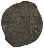 Pièce de monnaie antique du vieux métal d'isolement photographie stock