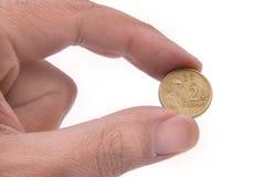 Pièce de monnaie australienne retenue par deux doigts Photos libres de droits