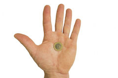 Pièce de monnaie dans la main de l'homme Image stock