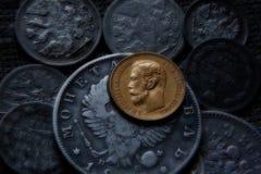 Pièce de monnaie de Russe d'argent et d'or Photographie stock libre de droits