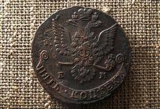 Pièce de monnaie en cuivre avec un aigle Photos libres de droits