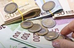 Pièce de monnaie grabing de main Images stock