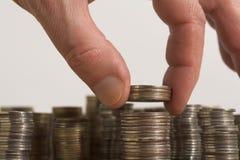 Pièce de monnaie par la pièce de monnaie? Photo stock
