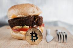 Pièce de monnaie savoureuse de bitcoin Photos libres de droits