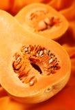 Pièce de potiron sur l'orange Photographie stock libre de droits