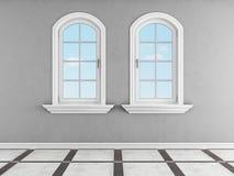 Pièce grise avec deux fenêtres arquées Images stock