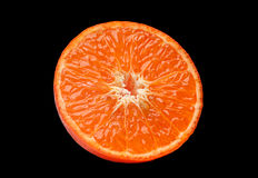 Pièce orange de fruit sur le noir Photographie stock