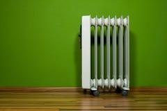 Pièce verte avec le radiateur Photographie stock