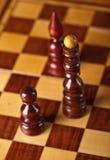 Pièces d'échecs à bord Photographie stock