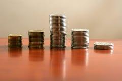 Pièces d'or et en argent Images stock